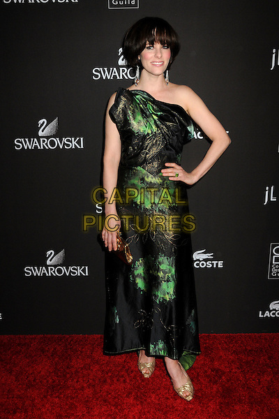 PARKER POSEY .Attending the 12th Annual Costume Designers Guild Awards held at the Beverly Hilton Hotel.  .Beverly Hills, California, USA,  .25th February 2010 .arrivals full length long maxi green print dress hand on hip black gold clutch bag peep toe shoes one shoulder .CAP/ADM/BP.©Byron Purvis/AdMedia/Capital Pictures.
