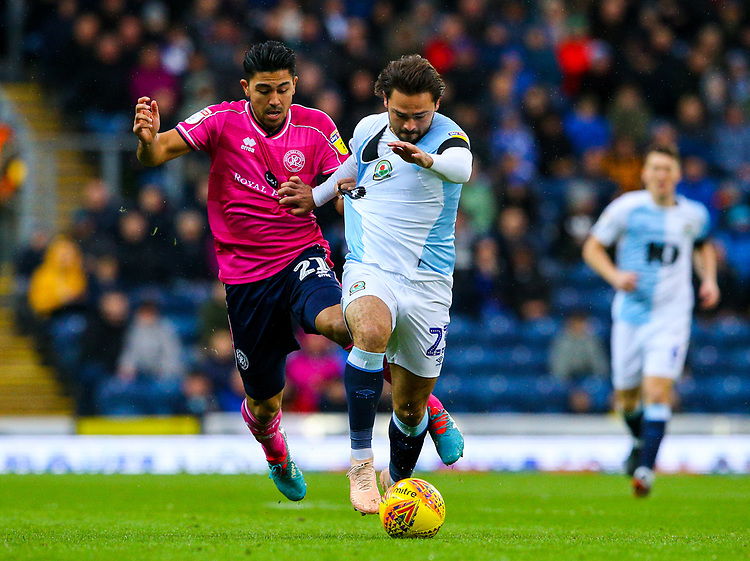 Blackburn Rovers' Bradley Dack holds off the challenge from Queens Park Rangers' Massimo Luongo<br /> <br /> Photographer Alex Dodd/CameraSport<br /> <br /> The EFL Sky Bet Championship - Blackburn Rovers v Queens Park Rangers - Saturday 3rd November 2018 - Ewood Park - Blackburn<br /> <br /> World Copyright © 2018 CameraSport. All rights reserved. 43 Linden Ave. Countesthorpe. Leicester. England. LE8 5PG - Tel: +44 (0) 116 277 4147 - admin@camerasport.com - www.camerasport.com