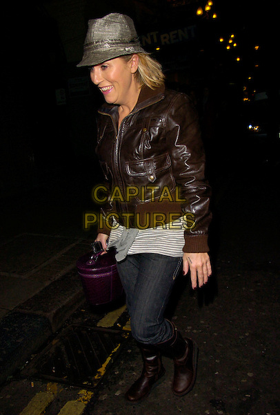 """JESSIE WALLACE.At the """"Rent"""" Musical Cast Change First Night Performance at the Duke Of York's Theatre, London, England, .December 27th 2007..full length brown leather bomber jacket jeans boots hat .CAP/CAN.©Can Nguyen/Capital Pictures"""