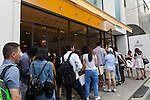 Customers wait in a long line to enter the new pastry shop ''Dominique Ansel Bakery'' in Omotesando Hills on June 20, 2015, Tokyo, Japan. Japan is the first country outside the USA for the popular New York bakery to open a store. According to organizers, about 400 customers waited 3 to 4 hours in the morning to taste its original desserts such as the ''Cronut'' a croissant doughnut fusion creation by Chef Dominique Ansel. (Photo by Rodrigo Reyes Marin/AFLO)