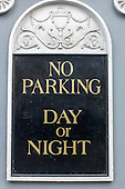 Dublin, Republic of Ireland. No Parking Day or Night sign in Gold and Black.