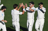 Trent Boult celebrates the wicket of Cook wtih Southee and Latham.<br /> New Zealand Blackcaps v England. 1st day/night test match. Eden Park, Auckland, New Zealand. Day 4, Sunday 25 March 2018. &copy; Copyright Photo: Andrew Cornaga / www.Photosport.nz