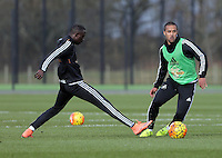 Pictured L-R: Modou Barrow against Wayne Routledge Thursday 25 February<br /> Re: Swansea City FC training at Fairwood, near Swansea, Wales, UK, ahead of their game against Tottenham Hotspur.