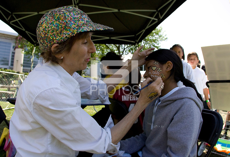 26 April 2009: A painter applies temporary FC Gold Pride facepaint on a young girl's chin before the game between Washington Freedom and FC Gold Pride at Buck Shaw Stadium in Santa Clara, California.   Washington Freedom defeated FC Gold Pride, 4-3.