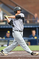 Oakland Golden Grizzlies first baseman Zach Sterry (5) follows through on his swing against the Michigan Wolverines on May 17, 2016 at Ray Fisher Stadium in Ann Arbor, Michigan. Oakland defeated Michigan 6-5 in 10 innings. (Andrew Woolley/Four Seam Images)