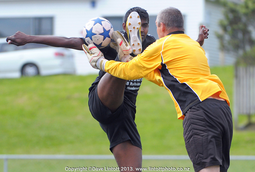 Action from the match between Poland (keeper in yellow) and Bula Boys (black) during the 2013 NZ Communities Cup football tournament at Wakefield Park,  Wellington, New Zealand, on Saturday, 30 November 2013. Photo: Dave Lintott / lintottphoto.co.nz