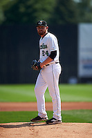 Clinton LumberKings pitcher Zack Littell (24) gets ready to deliver a pitch during a game against the Great Lakes Loons on August 16, 2015 at Ashford University Field in Clinton, Iowa.  Great Lakes defeated Clinton 3-2.  (Mike Janes/Four Seam Images)