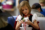 Laila Olsen, 6, makes yarn art at the Boo-nanza event at the Carson City Library, in Carson City, Nev., on Tuesday, Oct. 30, 2018. <br /> Photo by Cathleen Allison/Nevada Momentum