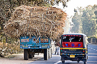 Nearly every truck in India has the sign Blow Horn! So a typically overloaded tuk tuk obliges while overtaking on the road from Delhi to Agra. (Photo by Matt Considine - Images of Asia Collection)