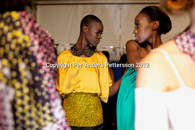 JOHANNESBURG, SOUTH AFRICA – MARCH 10: Models wait backstage before a show for the designer label Loin Cloth and Ashes at the Joburg Fashion Week on March 10 2012, at the Hyde Park Mall in Johannesburg, South Africa. South Africa's finest designers showed their 2012 Autumn & Winter collections during the 4 day event. (Photo by Per-Anders Pettersson)