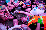 """A group of teens who call themselves """"kandi kids"""" look up at more than a thousand moving lights that change into multiple colors. The teens were high on Ecstasy and acid at Electric Daisy Carnival."""