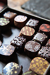 Close-up view of a box of chocolates from de Neuville fine chocolate and sweet shop,<br /> Rue Saint-Louis en L'ile, Ile Saint-Louis, Paris, France, Europe