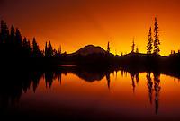 AJ3716, Mount Rainier, mirror, sunset, sunrise, Mt. Rainier National Park, Cascades, Cascade Range, Washington, Silhouette of Mt. Rainier at sunset reflecting in a mountain pond at Chinook Pass in the Cascade Mountain Range in Mount Rainier Nat'l Park in the state of Washington.