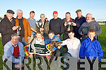 CHAMPION; Champion dog of the Lixnaw Coursing on Sunday was Cryptic Rebel the owner John O'Sullivan was presented with the winning trophy by chairman of the Lixnaw Coursing Martin Galvin with the O'Carroll-O'Connor Cup, Front l-r: Matt O'Connor (jnr), Michael Nolan, Jack Nolan, Matthew O'Connor and Jack Guiney. Back l-r: Matt O'Connor (snr) President Lixnaw Coursing), Larry Dowling, John O'Sullivan, Martin Galvin (Chairman), John Greaney, Neily Nolan, Pat McMahon and Patrick Mulvihill.............