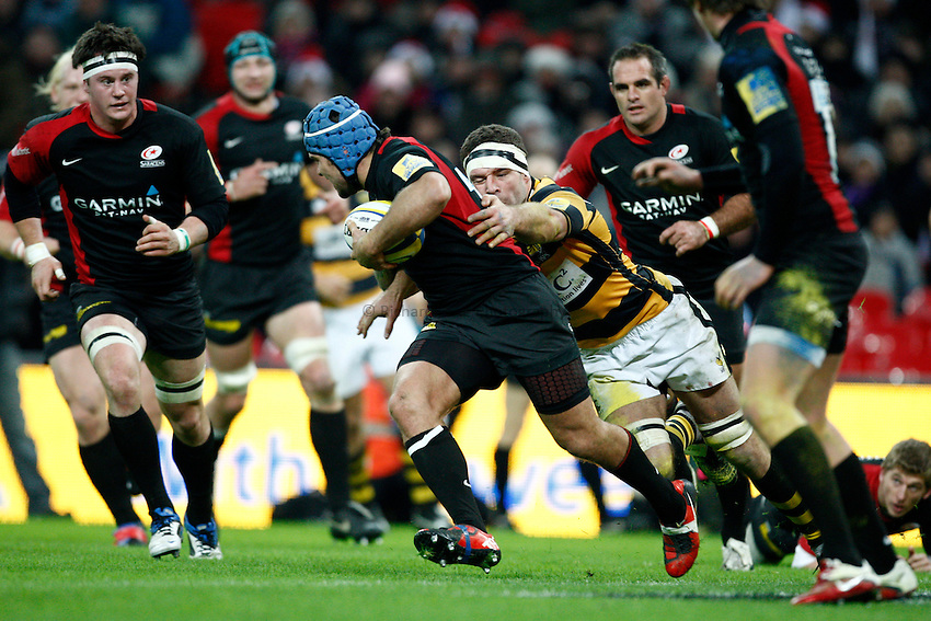 Photo: Richard Lane/Richard Lane Photography. Saracens v London Wasps. Aviva Premiership. 26/12/2010. Saracens' Schalk Brits is tackled by Wasps' Joe Worsley.