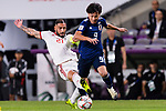 Minamino Takumi of Japan (R) fights for the ball with Seyed Ashkan Dejagah of Iran (L) during the AFC Asian Cup UAE 2019 Semi Finals match between I.R. Iran (IRN) and Japan (JPN) at Hazza Bin Zayed Stadium  on 28 January 2019 in Al Alin, United Arab Emirates. Photo by Marcio Rodrigo Machado / Power Sport Images