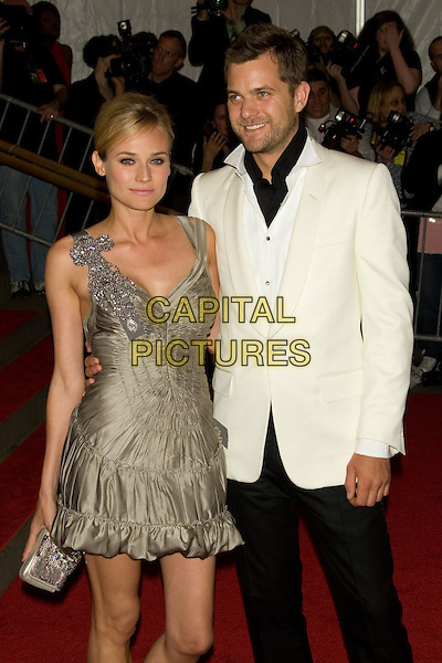 "DIANE KRUGER & JOSHUA JACKSON.Costume Institute Gala - ""Superheroes: Fashion and Fantasy"" at The Metropolitan Museum of Art, New York, NY, USA..May 5th, 2008 .half length beige brown gold dress white suit jacket couple clutch bag purse ruffles ruffled 3/4.CAP/LNC.©TOM/LNC/Capital Pictures."