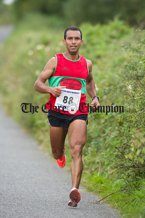 Julius Ceaser Castro on his way to taking second place during the Declan Hayes Memorial Doonbeg Half Marathon/10K Fun Run and Walk. Photograph by John Kelly.