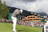 Tyrrell Hatton (ENG) plays his 2nd shot on the 18th hole during Sunday's Final Round of the 2017 Omega European Masters held at Golf Club Crans-Sur-Sierre, Crans Montana, Switzerland. 10th September 2017.<br /> Picture: Eoin Clarke | Golffile<br /> <br /> <br /> All photos usage must carry mandatory copyright credit (&copy; Golffile | Eoin Clarke)