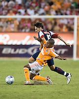 CD Guadalajara midfielder Edgar Solis (16) fights Houston Dynamo midfielder Corey Ashe (26) for the ball.  CD Guadalajara defeated Houston Dynamo 1-0 during the group stage of the Superliga 2008 tournament at Robertson Stadium in Houston, TX on July 15, 2008.