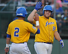 Zach Fritz #24, East Meadow third baseman, right, gets congratulated by Justin Reyes #2 after crossing home plate in the bottom of the first inning in Game 3 of the Nassau County varsity baseball Class AA finals against Massapequa at Farmingdale State College on Wednesday, June 1, 2016. East Meadow led 5-0 after four and a half innings.