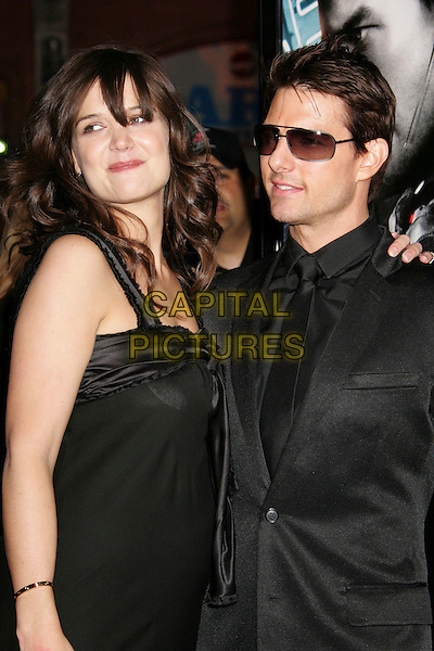"KATIE HOLMES & TOM CRUISE.""Mission: Impossible III"" Fan Screening held at Grauman's Chinese Theater, Hollywood, California, USA,.04 May 2006..3 half length black dress couple see-through breast nursing pads.Ref: ADM/RE.www.capitalpictures.com.sales@capitalpictures.com.©Russ Elliot/AdMedia/Capital Pictures."