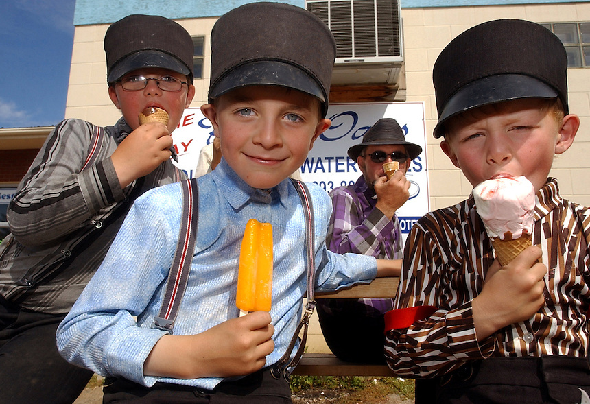 After a morning of picking apples in near 30 C heat, members of the Baildon Hutterite Colony cool off with ice cream from the Snow Hut in Moose Jaw. From left to right is Eli Wipf, 7, cousin Joshua Wipf, 7, Peter Wipf, and Kevin Hofer, 6. MARK TAYLOR/Moose Jaw Times-Herald