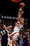 MADISON, WI - NOVEMBER 3: Guard Jason Bohannon #12 of the Wisconsin Badgers shoots the ball against the University of Wisconsin-Stout Blue Devils at the Kohl Center on September 3, 2006 in Madison, Wisconsin. The Badgers beat the Blue Devils 82-33. Photo by David Stluka