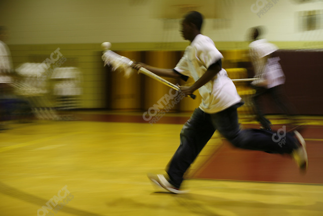 Boys playing lacrosse at the Frederick Douglass Academy in in Harlem, New York City, New York, July 25, 2007
