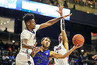 Washington, DC - December 22, 2018: Hampton Pirates guard Jermaine Marrow (2) makes a layup between two Howard Bison defenders during the DC Hoops Fest between Hampton and Howard at  Entertainment and Sports Arena in Washington, DC.   (Photo by Elliott Brown/Media Images International)