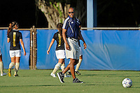 21 August 2011:  FIU Head Coach Thomas Chestnutt watches as his players run through warm-up drills prior to the match.  The University of Florida Gators defeated the FIU Golden Panthers, 2-0, at University Park Stadium in Miami, Florida.