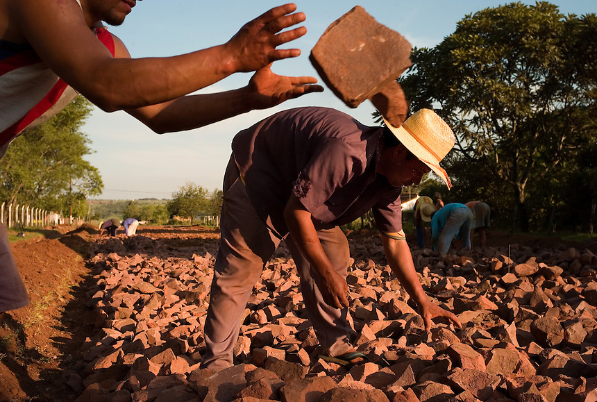 Workers cobble a street in the former mission town of Santa Maria de Fé (acute accent on the e in Fe), Paraguay in jobs that pay two dollars a day. Scores of Jesuit missions in the area where Paraguay, Argentina and Brazil meet were built in the 17th century and abandoned when the Jesuits were expelled in the 18th century. Ruins of some of these missions still haunt hilltops in the region. (Kevin Moloney for the New York Times)
