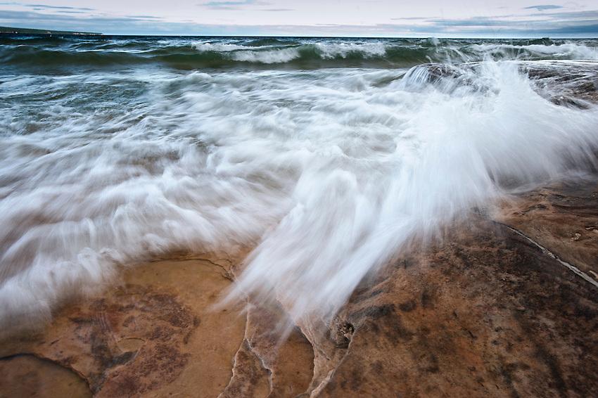 Stormy Lake Superior beach at Pictured Rocks National Lakeshore near Munising Michigan in Michigan's Upper Peninsula.