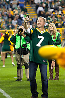 Former Green Bay Packer quarterback Don Majkowski takes a selfie at Lambeau Field during alumni introductions prior to the kickoff betwen the Seattle Seahawks and the Packers on Sept. 20, 2015.