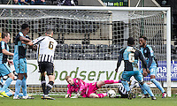 Goalkeeper Ryan Allsop (Loanee from Bournemouth) of Wycombe Wanderers pulls off a save to clean it level at 0 0 during the Sky Bet League 2 match between Notts County and Wycombe Wanderers at Meadow Lane, Nottingham, England on 28 March 2016. Photo by Andy Rowland.