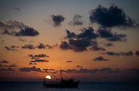 Sunset over a fishing boat on Little Corn Island, Nicaragua, April, 2009.