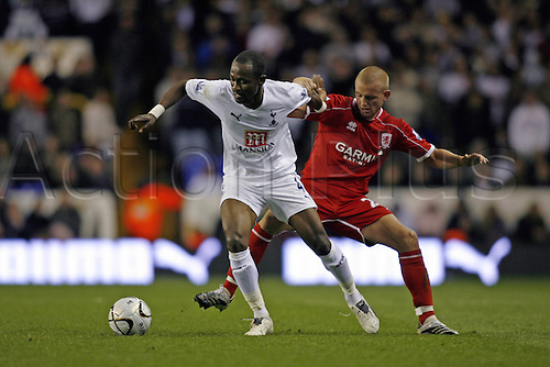 26 September 2007: Tottenham midfielder Didier Zokora shields the ball from Lee Catermole during the Carling Cup game between Tottenham Hotspur and Middlesbrough, played at White Hart Lane. Spurs won the match 2-0. Photo: Actionplus....070926 football soccer player