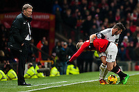Saturday 11 January 2014 Pictured: David Moyes, Manager of Manchester United looks on as Alexander B?ttner  and Alejandro Pozuelo get in a a tangle <br /> Re: Barclays Premier League Manchester Utd v Swansea City FC  at Old Trafford, Manchester