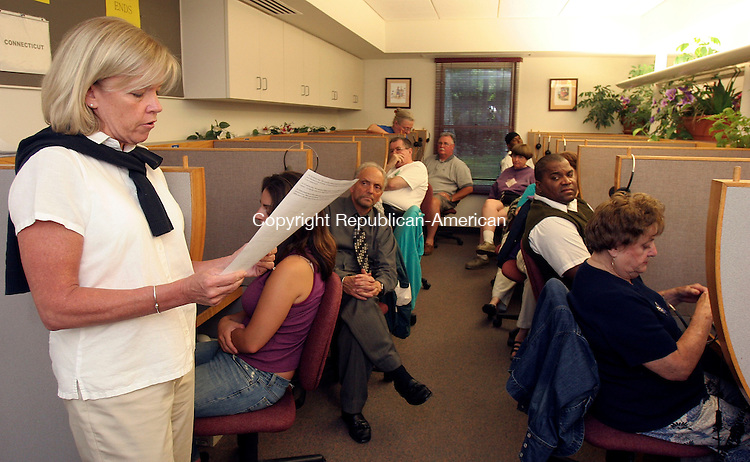 HAMDEN, CT-25July 2006-072506TK20- (left) At the Quinnipiac University Polling Institute, Dorothy Donarum, Manager of Interview Operation briefed poll takers on sample questions that are to be asked on Lieberman's campaign.  Tom Kabelka Republican-American (Dorothy Donarum)