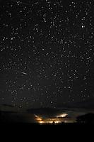 Lightning storm under a starry sky