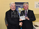 Principal of Monastery N.S. Ardee Jim McGee makes a presentation to Canon Peter Murphy who was celebrating 40 years in the priesthood. Photo:Colin Bell/pressphotos.ie