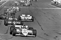 PHOENIX, AZ - APRIL 15: Bobby Rahal leads a group of cars in his March 84C 11/Cosworth at the Dana Jimmy Bryan 150 IndyCar race on April 15, 1984, at Phoenix International Raceway near Phoenix, Arizona.