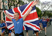 06 MAY 2004 - FUNCHAL, MADEIRA - Britains Rob Owen flies the flag at the Parade of Nations at the World Triathlon Championships. (PHOTO (C) NIGEL FARROW)