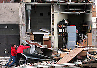 Aplington-Parkersburg students move debris to clear a doorway outside the high school Tuesday, May 27, 2008 in Parkersburg. An EF5 tornado destroyed the high school and wiped out the southern third of Parkersburg two days before, claiming the lives of six people in Parkersburg and two in nearby New Hartford.