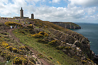 Tourists walking down a dirt path from the lighthouses at Cap Fréhel, Brittany, France.