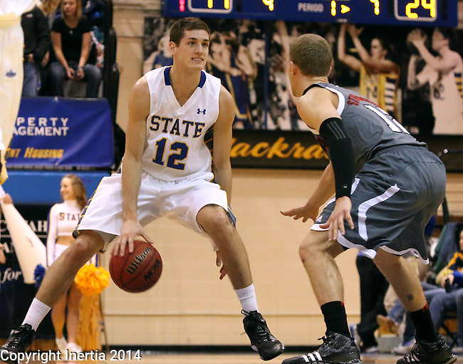 BROOKINGS, SD - JANUARY 18:  Brayden Carlson #12 from South Dakota State University dribbles against the defense of Caleb Steffensmeier #12 from Omaha in the first half of their Summit League game Saturday afternoon at Frost Arena in Brookings. (Photo by Dave Eggen/Inertia)