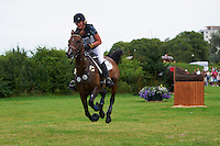 Beeke Kaack (GER) and Judy during the cross country test. Malmo City Horse Show FEI World Cup Eventing Qualifier CIC***. The couple was placed 28th after Friday's dressage and 17th after Saturday's cross country.<br /> Eventing in Ribersborg, Malmo, Sweden.<br /> August 2011.<br /> Only for editorial use.
