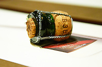 Mumm champagne cork after sabreing sabrage the bottle with wire cage.