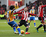 Kieron Freeman of Sheffield Utd shoots during the English League One match at the Bramall Lane Stadium, Sheffield. Picture date: November 19th, 2016. Pic Simon Bellis/Sportimage