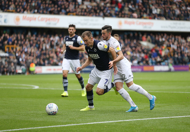 Leeds United's Jack Harrison and Millwall's Jed Wallace<br /> <br /> Photographer Rob Newell/CameraSport<br /> <br /> The EFL Sky Bet Championship - Millwall v Leeds United - Saturday 5th October 2019 - The Den - London<br /> <br /> World Copyright © 2019 CameraSport. All rights reserved. 43 Linden Ave. Countesthorpe. Leicester. England. LE8 5PG - Tel: +44 (0) 116 277 4147 - admin@camerasport.com - www.camerasport.com
